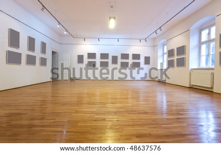 Empty art gallery with blank pictures on the wall - wide angle view - stock photo