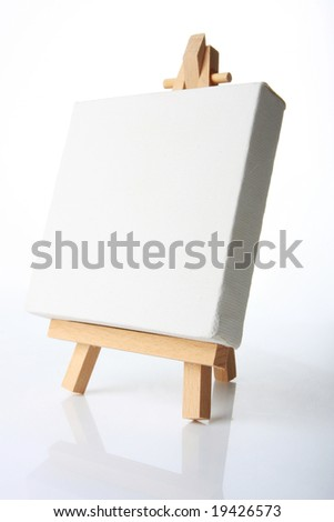 Empty artists canvas on an easel, shot on white, put your own image on it - stock photo