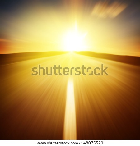 Empty asphalt road at sunset in motion blur. - stock photo