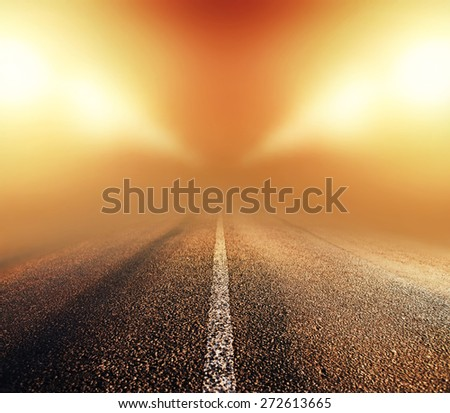 empty asphalt road in heavy fog at night - stock photo