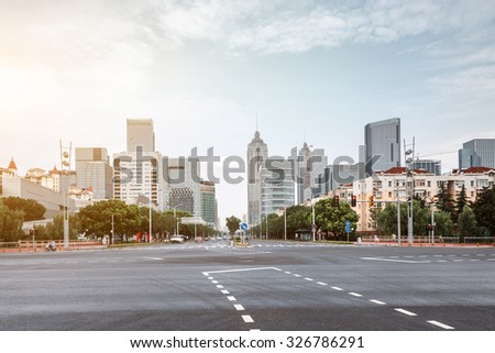 empty asphalt road in modern city under twilight