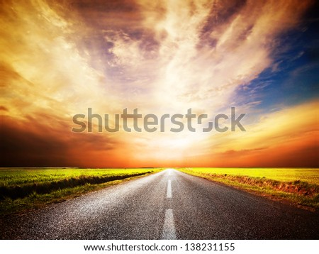Empty asphalt road. Long and straight. Sunset Sky