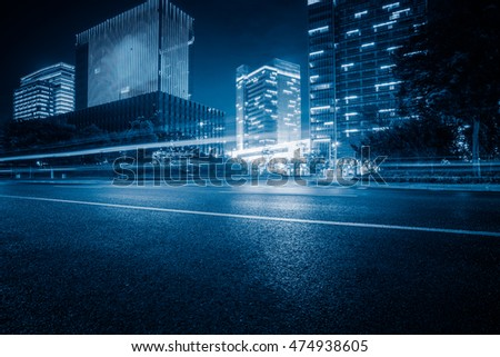 empty asphalt road with cityscape and skyline of Shanghai