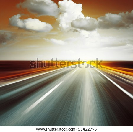 Empty asphalt road with cloudy red sky and sunlight - stock photo