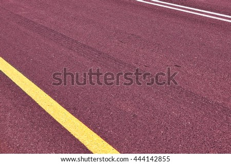 Empty asphalt two-way traffic road with a double solid white line and side restrictive yellow line. Road markings. Abstract background. Toned colors    - stock photo