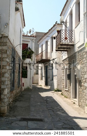 Empty back street of Skiathos town gives an atmosphere of relaxed calm. - stock photo