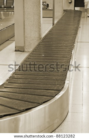 Empty baggage belt in the modern airport - stock photo