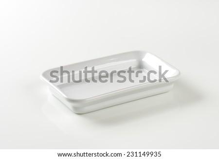 empty baking tray on white background - stock photo