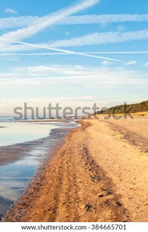 Empty Baltic sea shore in Saulkrasti, Latvia. Vibrant multicolored outdoors vertical image - stock photo