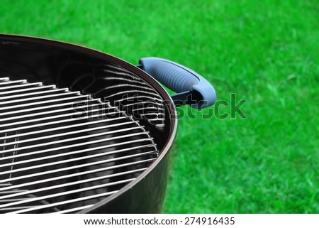 Empty Barbecue Grill Close-up In The Backyard Lawn  At Summer - stock photo