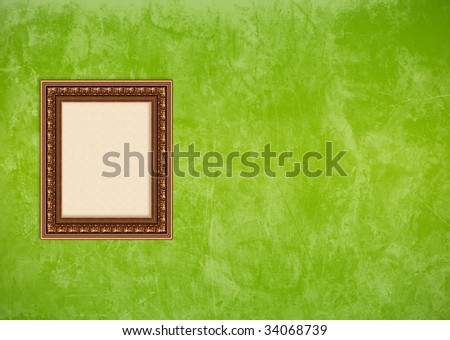 Empty baroque picture frame with copy space on a green grunge stucco wall - stock photo