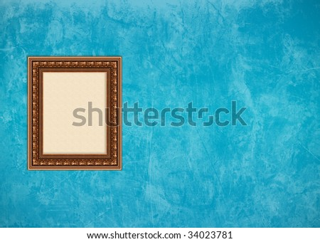 Empty baroque picture frame with copyspace on a blue grunge stucco wall - stock photo