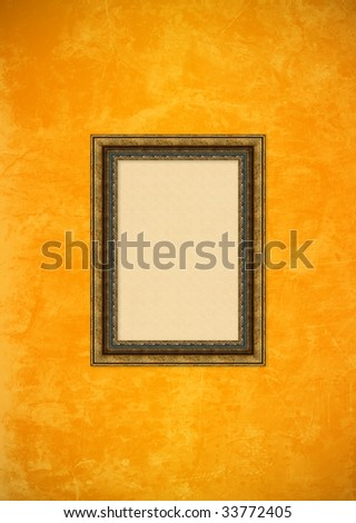 Empty baroque picture frame with copyspace on a grunge orange stucco wall - stock photo