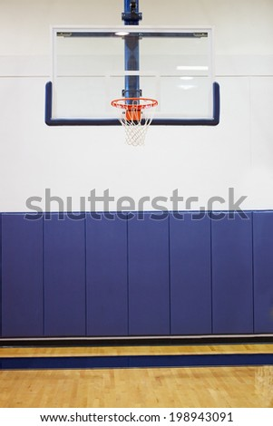 Empty Basketball Court In Gymnasium - stock photo