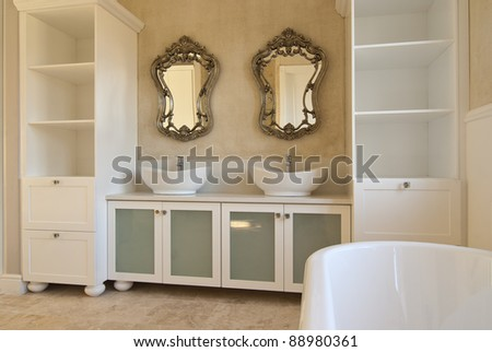 Empty bathroom inside a modern house - stock photo