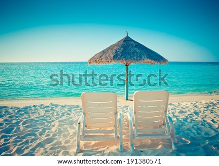 Empty beach chair before ocean,with a retro effect