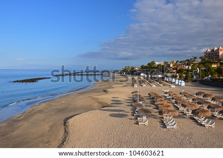 Empty beach El Duque in Costa Adeje resort, Tenerife, Canary Islands, Spain - stock photo
