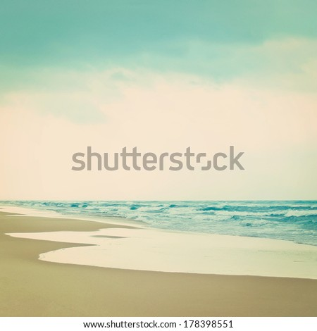 Empty beach, Mediterranean Sea. Vintage style. - stock photo