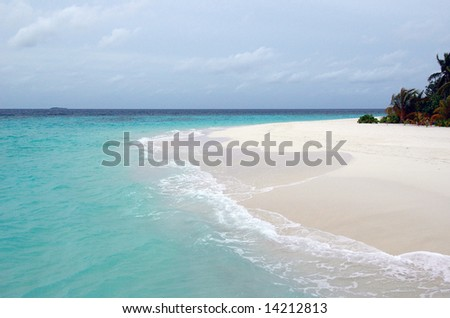 Empty beach of a coral atoll - stock photo
