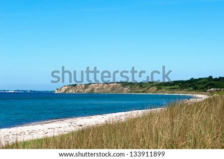Empty beach on the island Langeland, Denmark, on a clear summer day. - stock photo