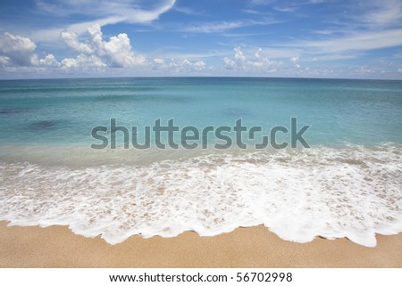 Empty beach with white wave spray - stock photo
