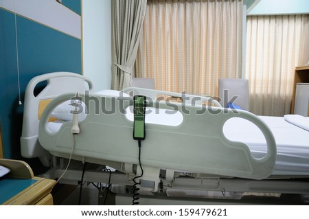 Empty bed in hospital room - stock photo