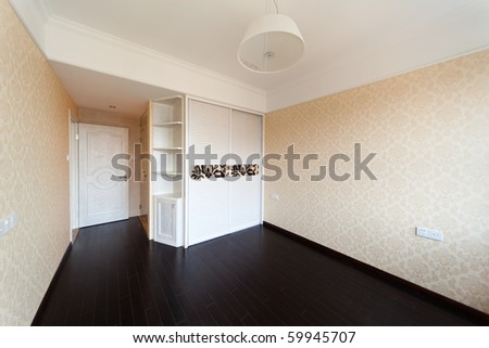 Empty bedroom with doorway and cabinet after renovation - stock photo