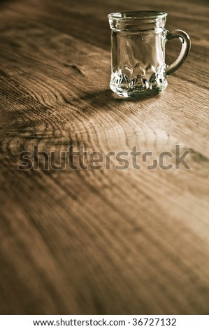 Empty beer glass on wooden background - stock photo