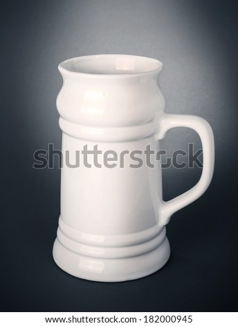 Empty beer mug on grey background - stock photo