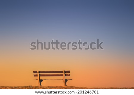 empty bench at dusk  - stock photo