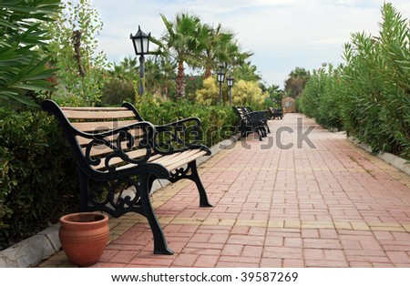 Empty Bench In Park With Lantern and Pot - stock photo