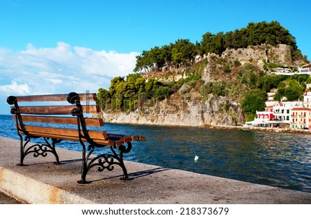 Empty bench in the port of Parga ,Greece. - stock photo