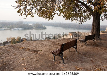 empty benches above the river - stock photo