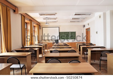 Empty big classroom at school - stock photo