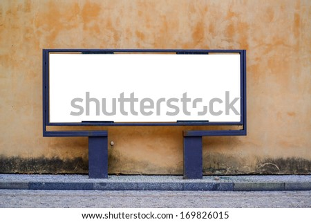 Empty billboard against urban background - stock photo