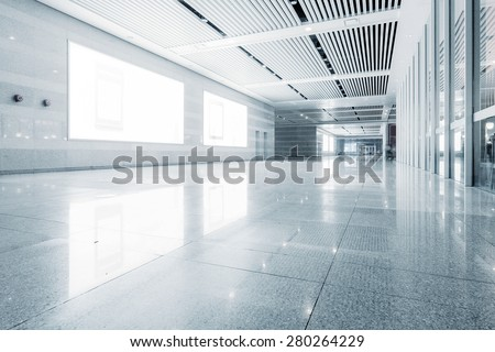 empty billboard and floor in shopping mall corridor - stock photo