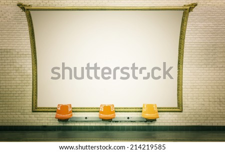 Empty billboard in Paris subway station with empty chairs - stock photo