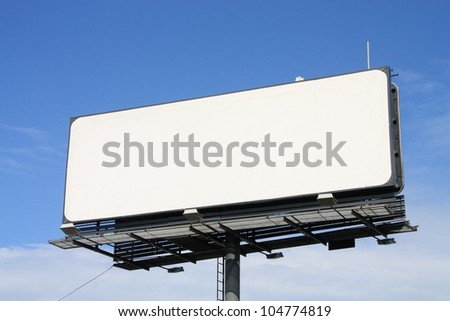 Empty billboard on cloudy sky. - stock photo