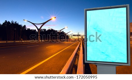 Empty billboard on night highway - stock photo