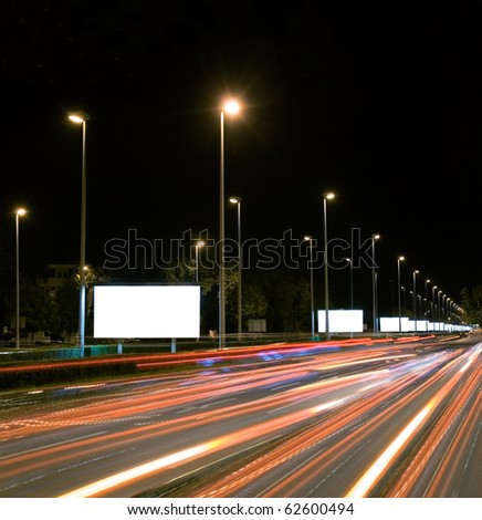 Empty billboards in the highway at night