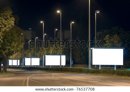 Empty billboards in the highway at night - stock photo