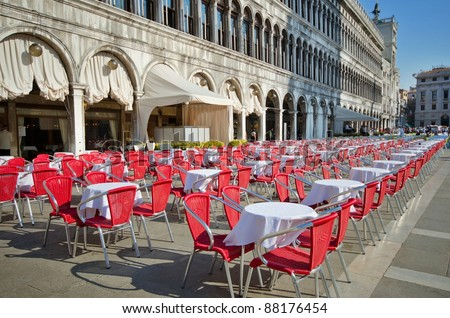 Empty bistro tables on San Marco square, Venice , Italy - stock photo