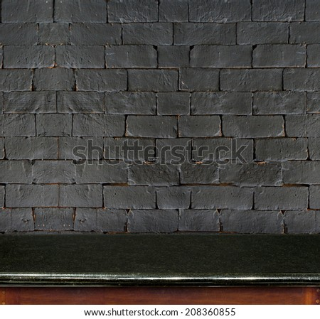Empty black marble table and black brick wall in background. product display template. - stock photo