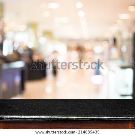 Empty black marble table and blur store in background. product display template. - stock photo