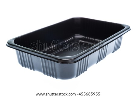 Empty black plastic container isolated on white background