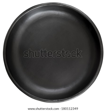 Empty black stoneware plate, isolated on white background. - stock photo