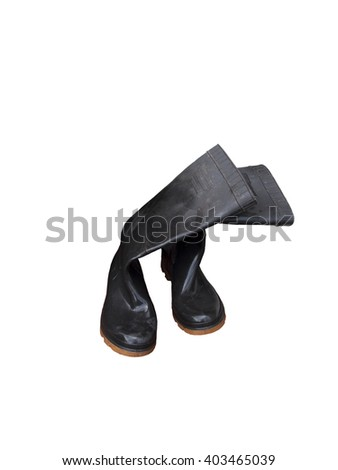 Empty black wellington boots, partially wet from recent use, isolated on white.