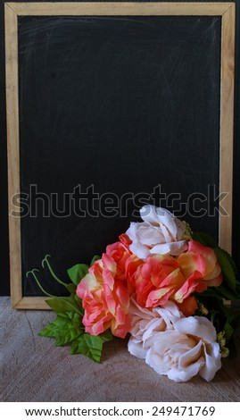 empty blackboard and flower - stock photo