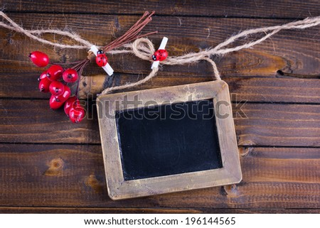 Empty blackboard  on wooden background. Horizontal.