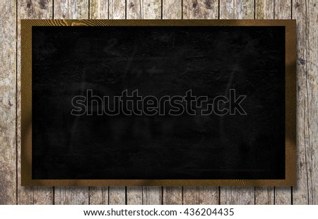 empty blackboard with wooden background